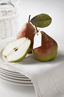 Pear Fruit On Stack Of White Plate