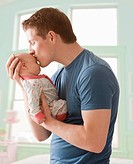 Caucasian father kissing baby girl