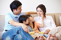 Portrait Of Family Eating Popcorn