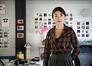 Japanese businesswoman standing in office