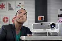 Japanese businessman working with projector