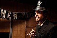 Hispanic man wearing hat for New Year´s Eve