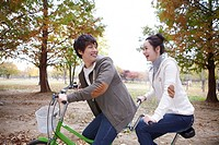 Young Couple Cycling In Autumn