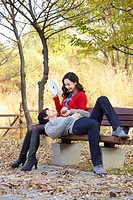 Man Lying On Woman´s Lap On Bench