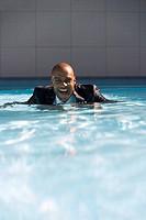 Businessman in swimming pool
