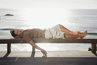 Man lying down on bench