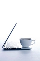 Coffee Cup And Laptop On Desk