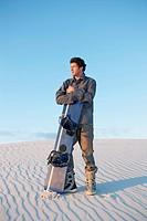 Sandboarder Standing in Desert