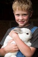 Young Boy Holding a Rabbit