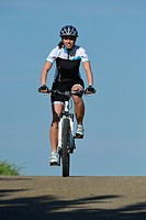 Female cyclist riding a mountain bike, bicycle, Stuttgart, Baden_Wuerttemberg, Germany, Europe, PublicGround