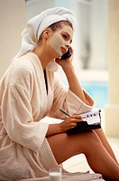 Woman Scheduling During Spa Visit