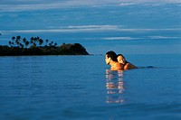 Couple Embracing in the Ocean