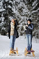 Two young women preparing for a sleigh ride, valley of Leitzachtal, Upper Bavaria, Bavaria, Germany, Europe