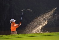Golfer Swinging His Club
