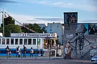 Banks of the river Spree and Berlin Wall mural, East Side Gallery, Berlin, Germany, Europe
