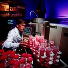 Technician with a Plasma Emission Spectrometer