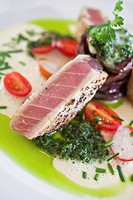 Seared tuna with sweet potato and coriander sandwich, made on fresh ginger and mild chili salsa with garlic foam, Restaurant The Foodbarn, Noordhoek, ...