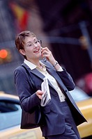 Businesswoman Using Cellular Phone