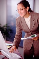 Smiling Businesswoman Typing
