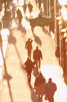 Silhouetted pedestrians in New York City