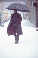 Businessman Walking to Work in the Snow