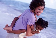 Mother Carrying Daughter on the Beach