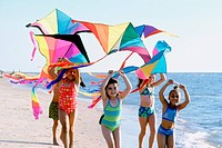Kids with colorful kites