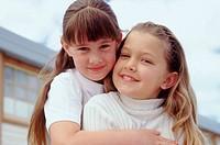 Embracing sisters