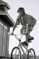 Boy Balancing on Bicycle