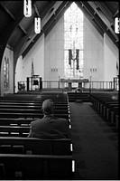 Man Sitting Alone in Church, Rear View