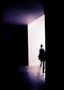 A person on the way out of a room.