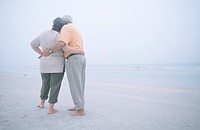 Senior couple hugging on the beach