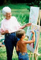 Grandmother painting with grandson