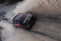 Rally Car Driving Fast Through Water