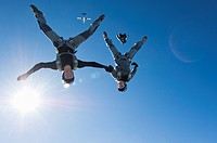 Couple parachuting