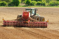 UK arable farming, tractor with seed drill, drilling spring barley,