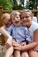 Three Laughing Children