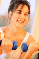 Portrait of a woman with dumbbells