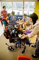 Trained staff members greet arriving blind, visually impaired, and handicapped children at the Blind Childrens' Learning Center in Santa Ana, CA