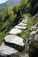 stone boulder paved hiking trail near village of mergoscia - canton of ticino - switzerland