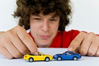 Boy playing with model cars