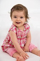 Baby girl sitting, smiling, portrait (thumbnail)