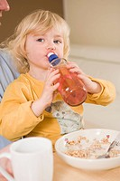 Girl drinking water in breakfast