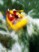Whitewater Rafting Down Waterfall