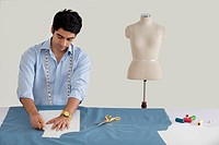 Male fashion designer working in fashion studio