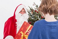 Santa Claus giving gift to boy