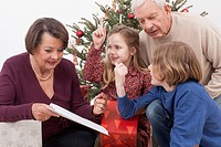 Grandchilds showing list of Christmas gifts