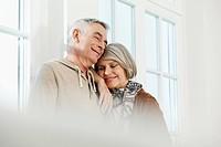 Germany, Berlin, Senior couple smiling