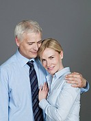 Mature couple embracing each other, smiling (thumbnail)