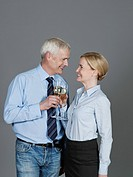 Mature couple drinking sparkling wine, smiling (thumbnail)